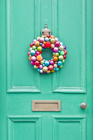 A door wreath gets the party vibe started before guests step inside your home.