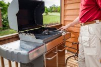 How to clean a backyard grill.