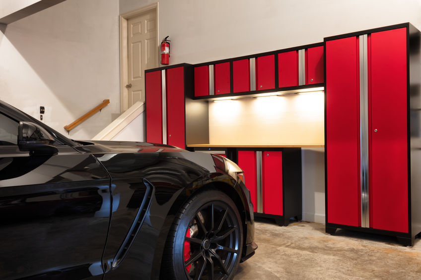 Garage storage tips include floor to ceiling cabinets.
