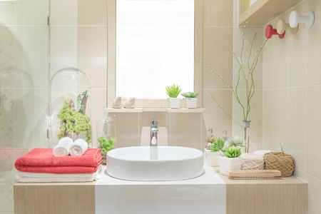 Guest bathroom ideas for a cozy retreat include thoughtful little extras such as fluffy towels and relaxing bubble bath.