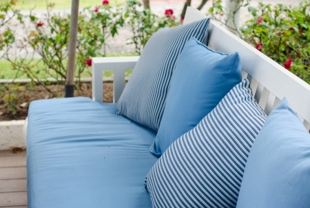 Cleaning patio furniture.