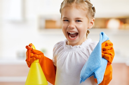 Age appropriate living room chores for the kids in includes sweeping or vacuuming the floor.