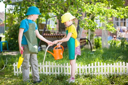 Spring cleaning with kids can include spring gardening chores